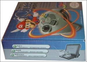 Banc d'essai du produit : 'iQue Player' et cartouche contenant cinq jeux