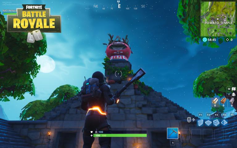 Chercher entre un géant de pierre, une tomate couronnée et un arbre dans un cercle : Guide Fortnite, saison 7, semaine 5